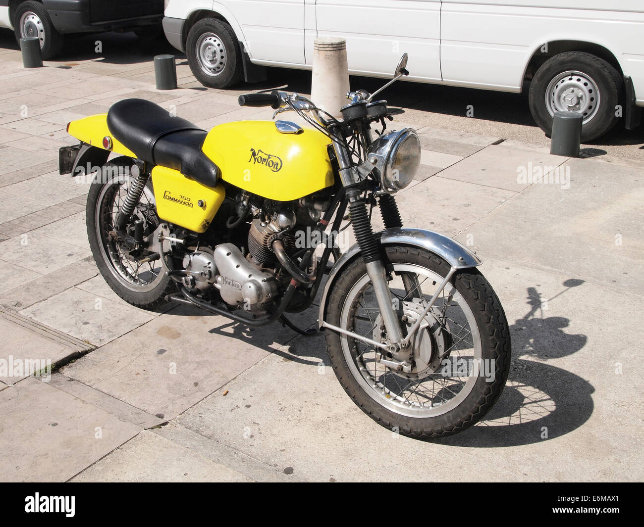 Yellow Vintage Norton Commando 750 Motorcycle Parked On A Square In Lons Le Saunier Jura Region France