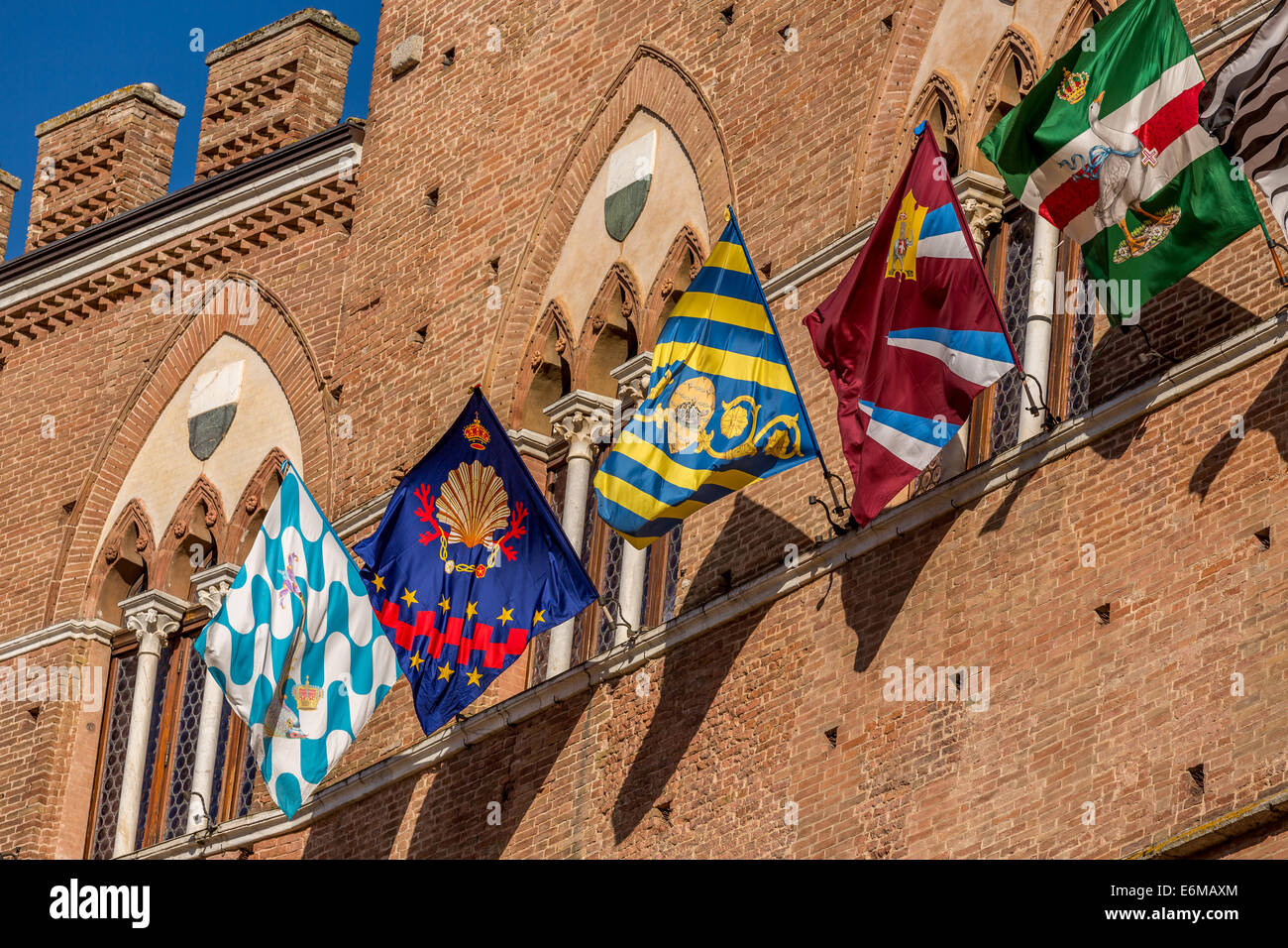 Siena on the day of the Palio horse race with flags and banners decorating the town hall, Siena, Italy - Stock Image