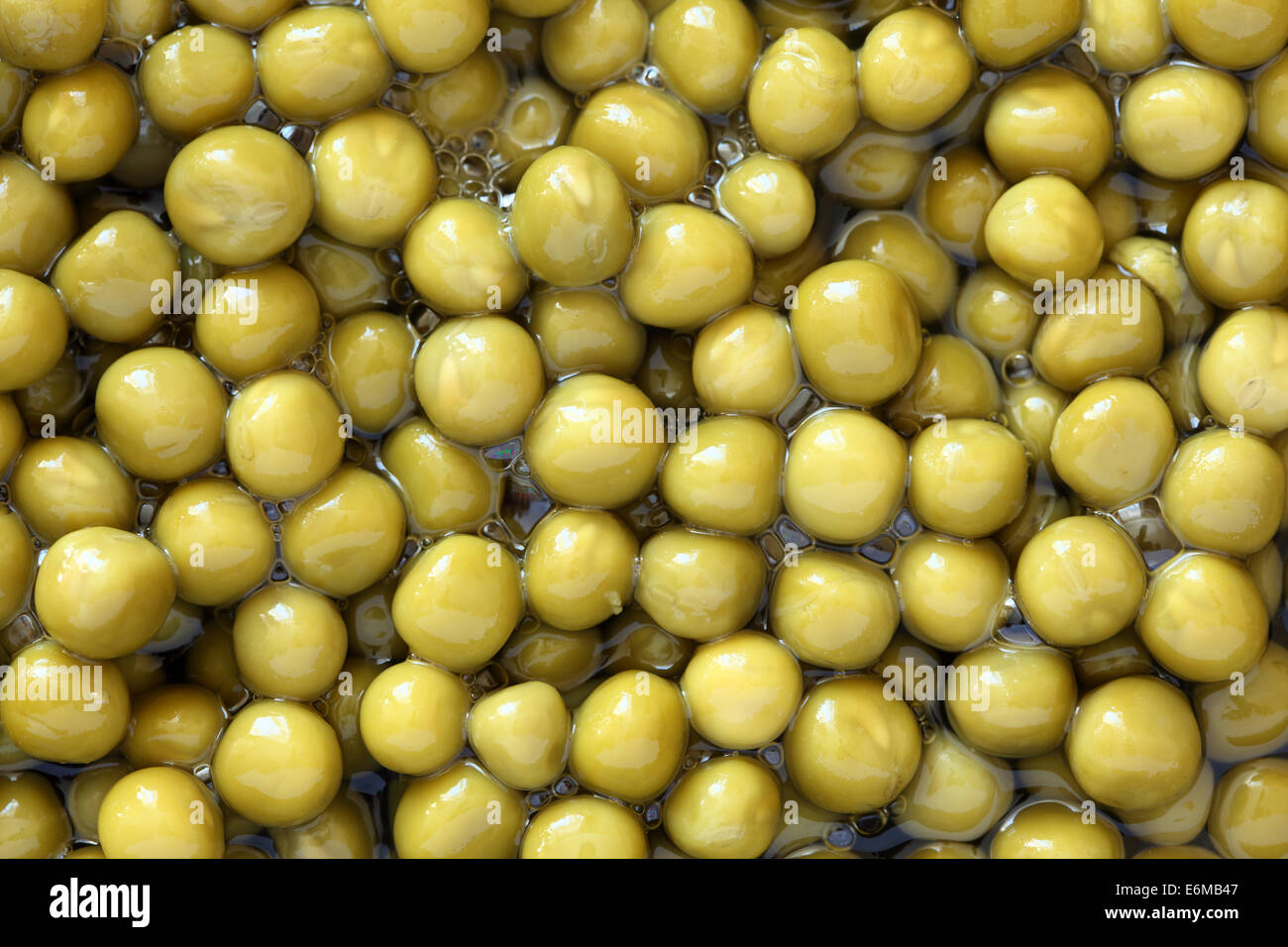 Preserved green peas background. - Stock Image