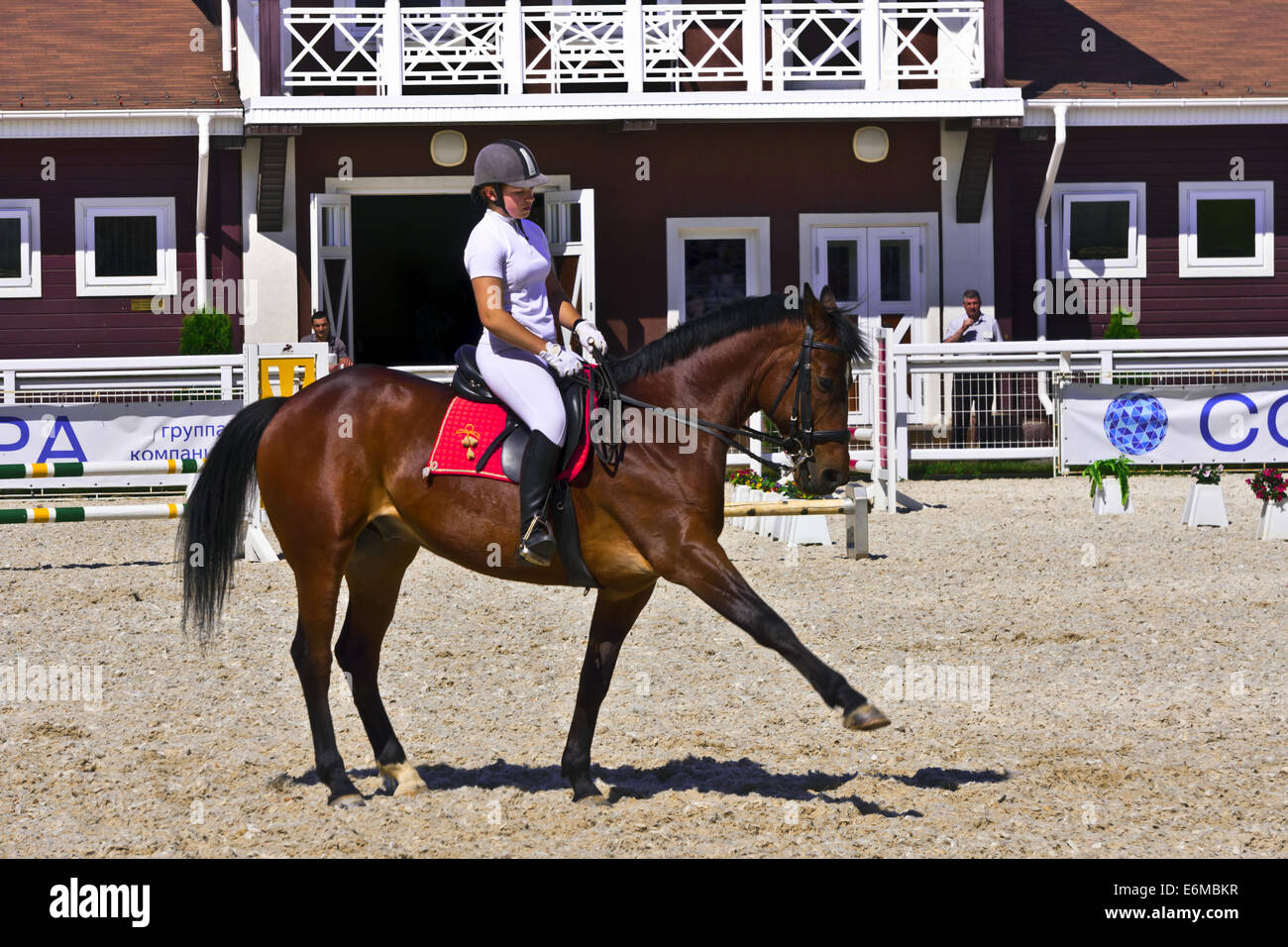 Female rider on a dark Arabian pure bred horse demonstrating dressage at the Groumant Horse Show in Tula, Russian - Stock Image