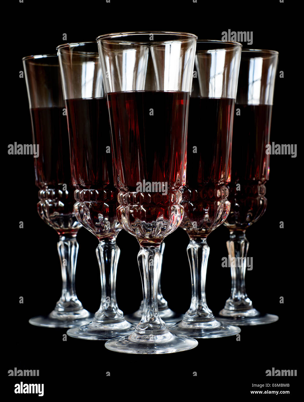 Wine glasses isolated over black background - Stock Image