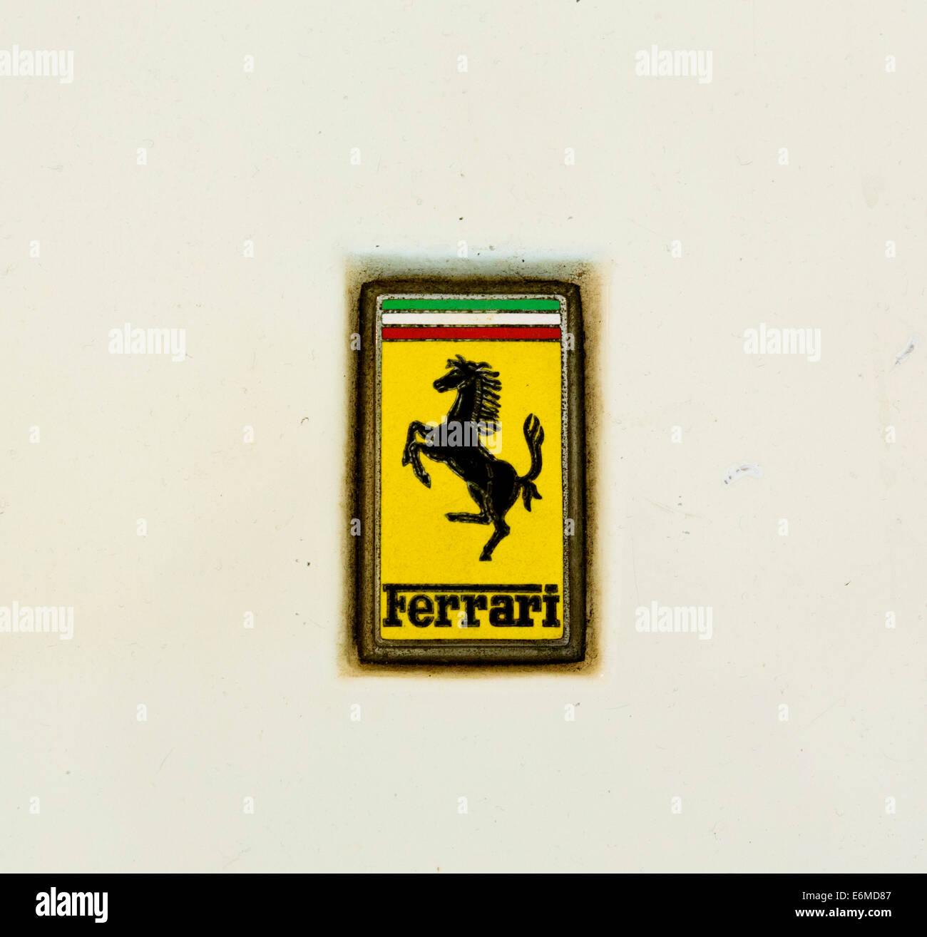 Ferrari badge on a racing car in the Museo Enzo Ferrari, Modena, Italy - Stock Image