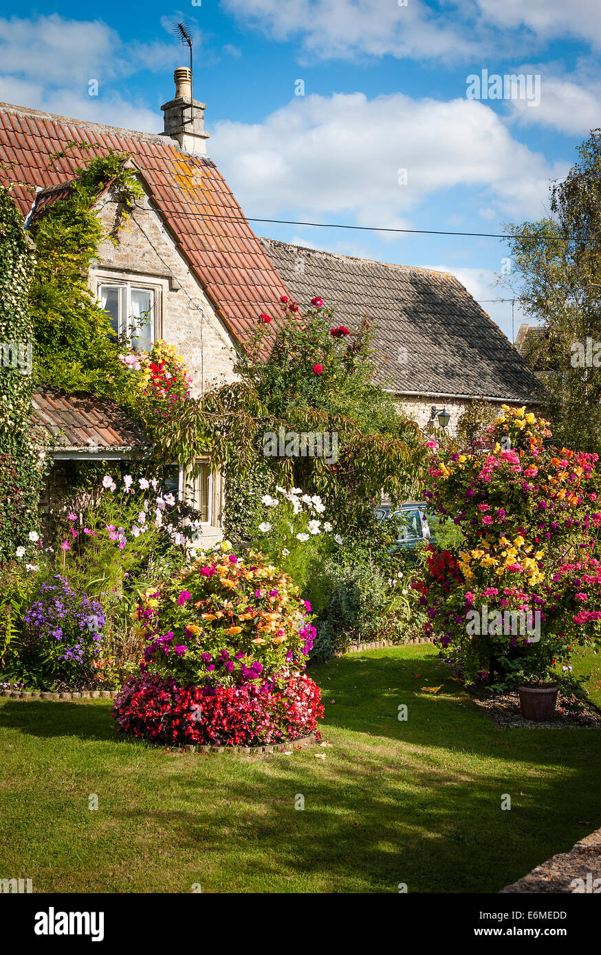 Small front flower garden in an English village - Stock Image
