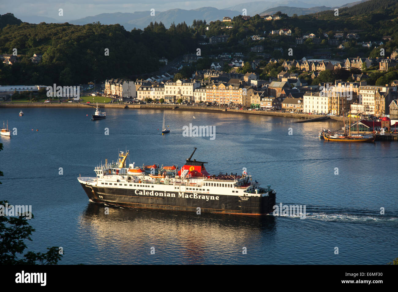 Calmac ferry leaving Oban harbour on a sunny evening, bound for Mull Stock Photo