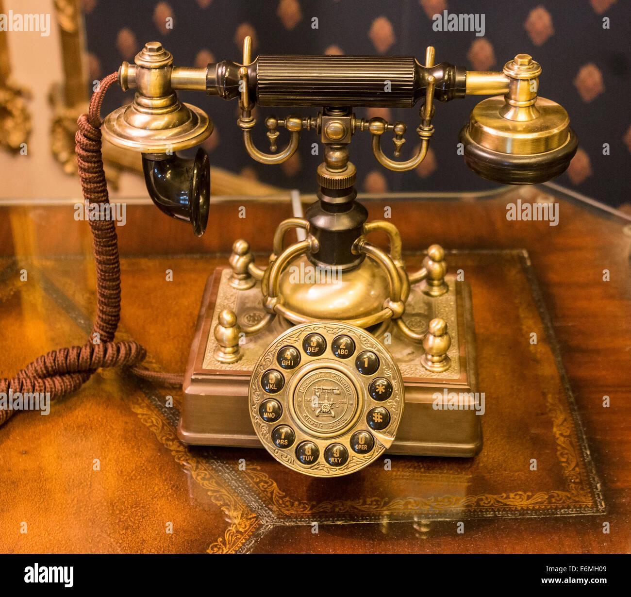 Antique style phone in lobby of Saskatchewan Radisson Plaza hotel, used as house phone. Saskatchewan, Regina, Canada - Stock Image