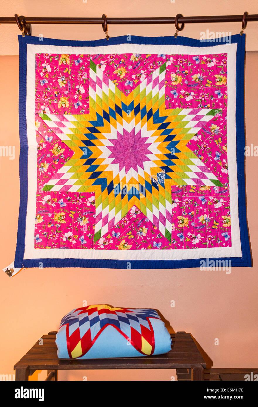 Quilt blanket by Pat Goudy, Nakota Sioux, for sale at Tatanka Boutique, Regina, Saskatchewan, Canada. - Stock Image