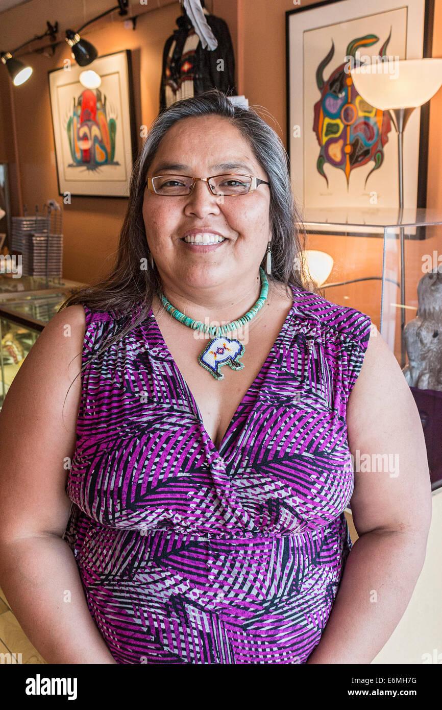 Joely Bigeagle, Nakota Sioux, owner of Tatanka Boutique in  Regina, Saskatchewan, Canada. - Stock Image