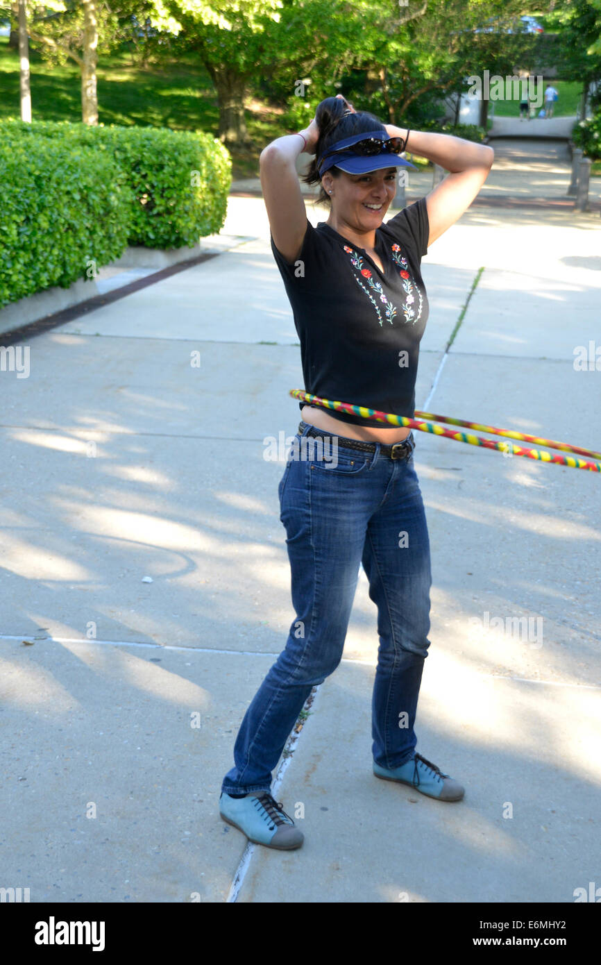 Girl enjoying a hula hoop - Stock Image
