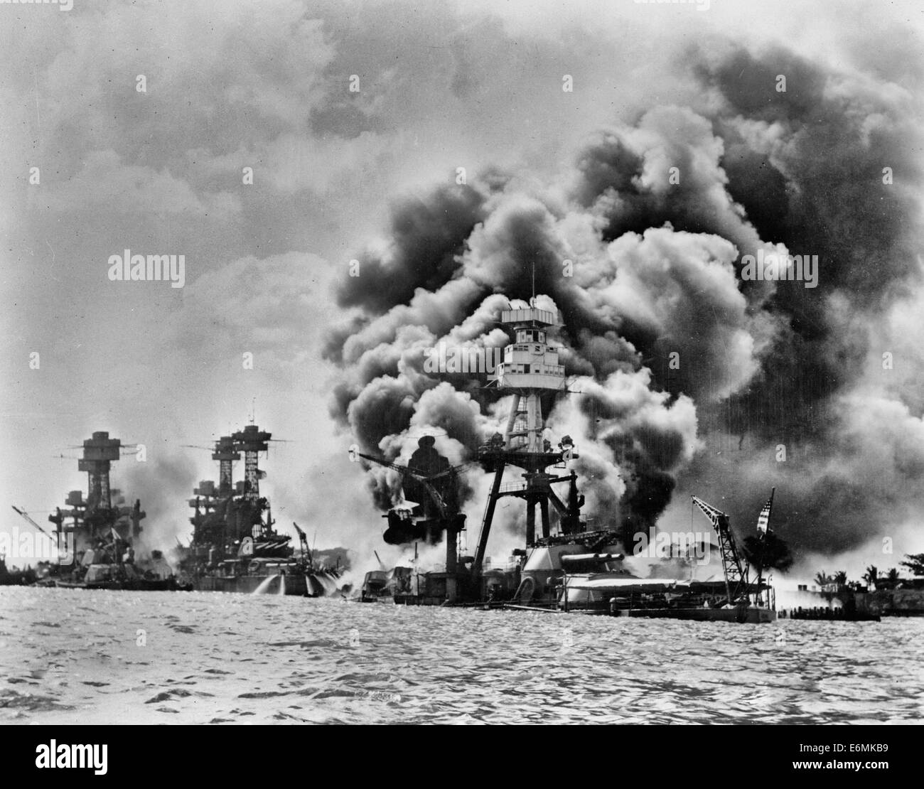 Stricken from the air. Three USA Battleships ablaze during the attack on Pearl Harbor - Stock Image