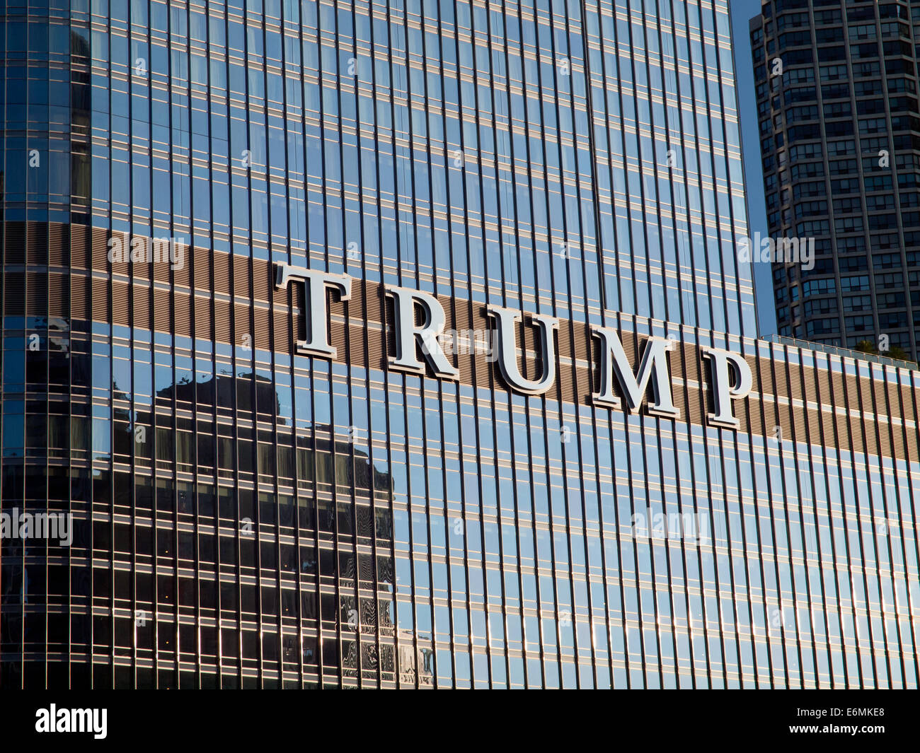 A view of the infamous TRUMP sign on the exterior of the Trump International Hotel and Tower in Chicago, Illinois. - Stock Image