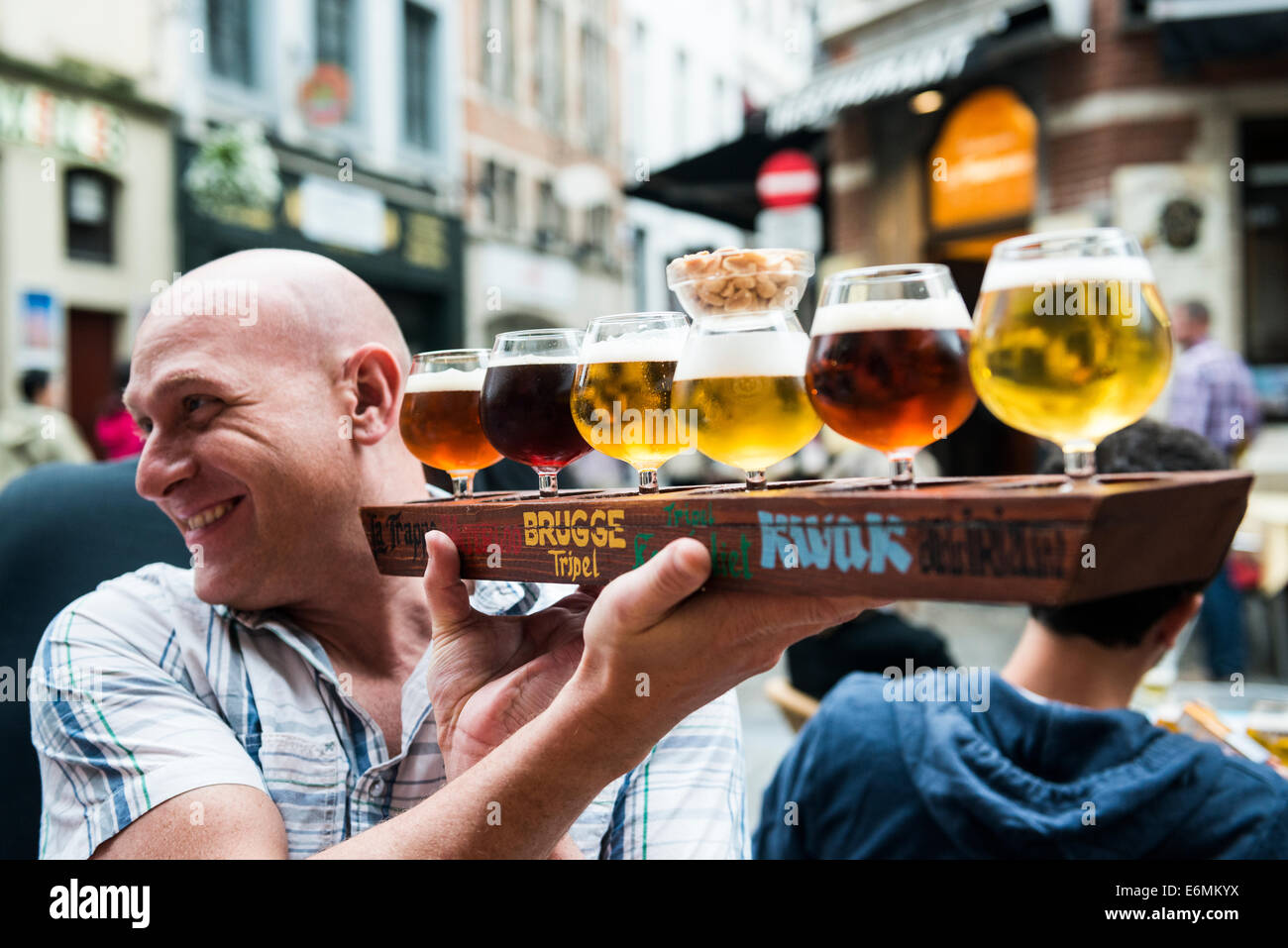 Beer tasting in one of the vibrant bars in the historical center of Brussels. Stock Photo