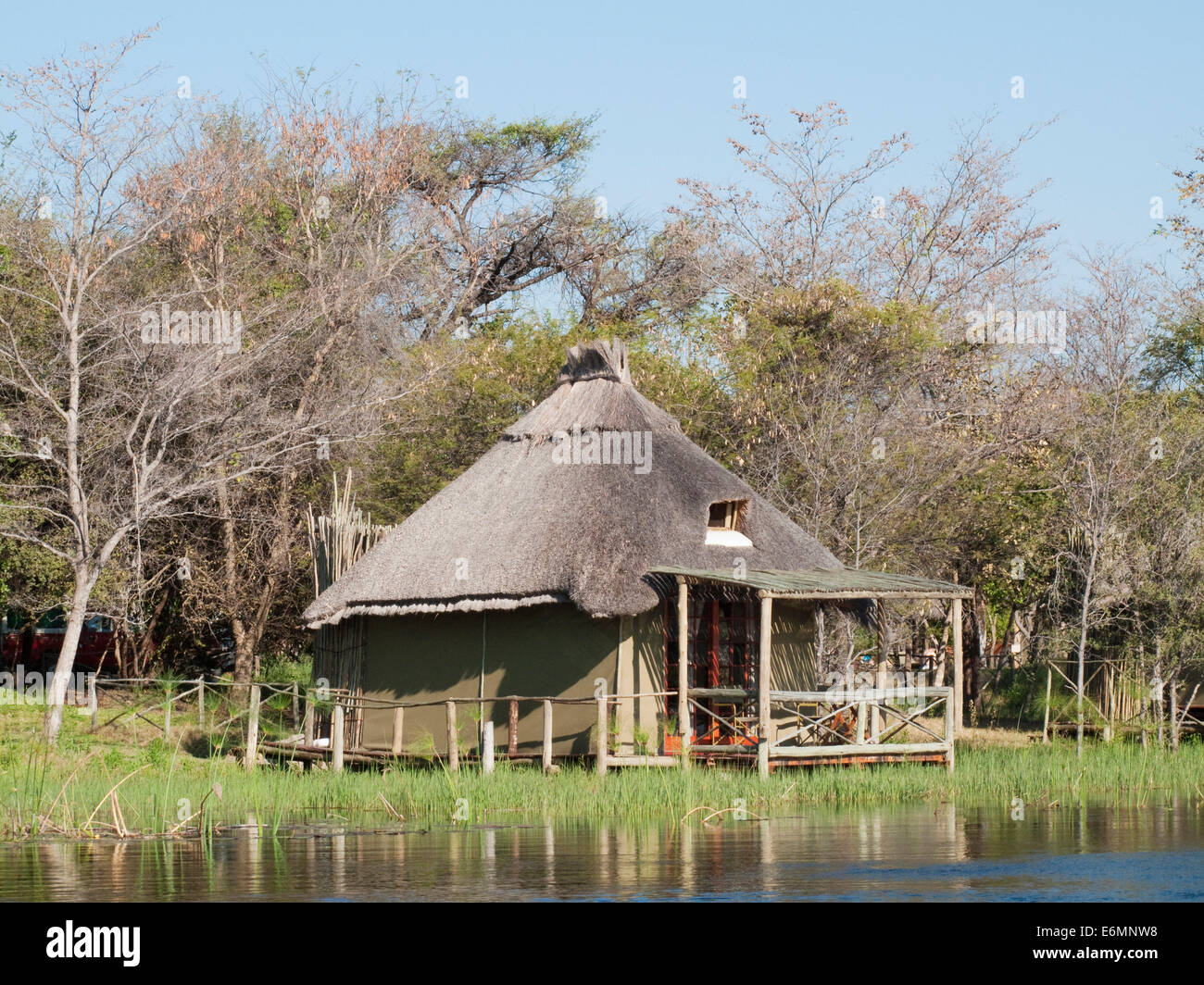 The so-called Island Tents accomodation at the Camp Kwando, built on poles right at the river bank of the Kwando - Stock Image