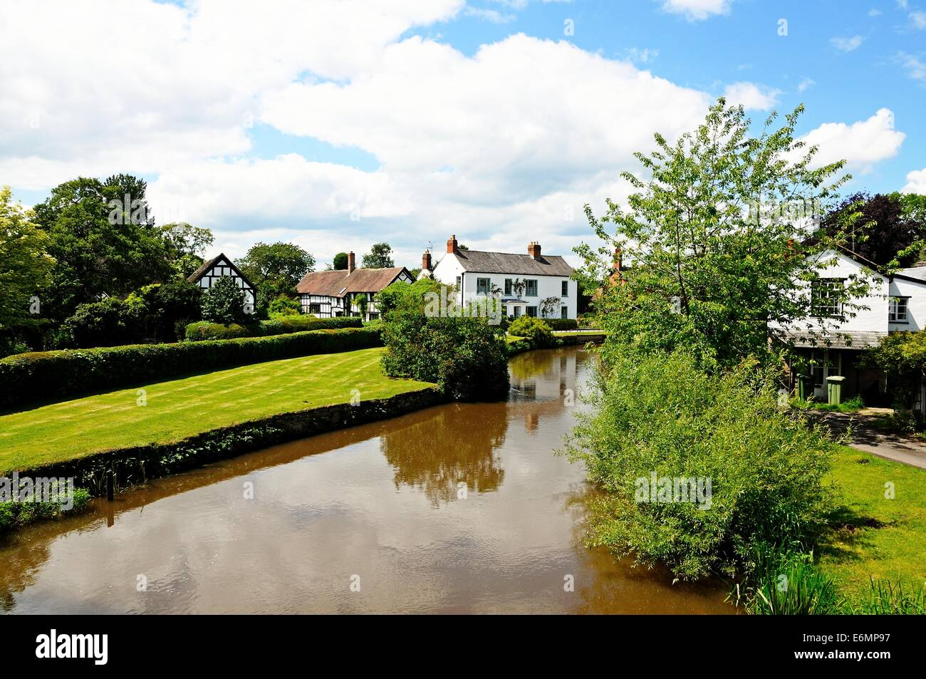 River Arrow with a pretty black and white timbered cottages to the rear, Eardisland, Herefordshire, England, UK, - Stock Image