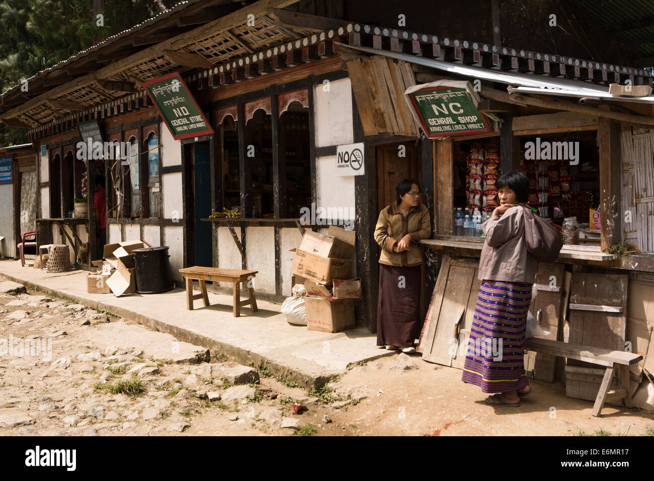 Eastern Bhutan, Trashigang, Kanglung, people shopping at General Stores in lower market - Stock Image