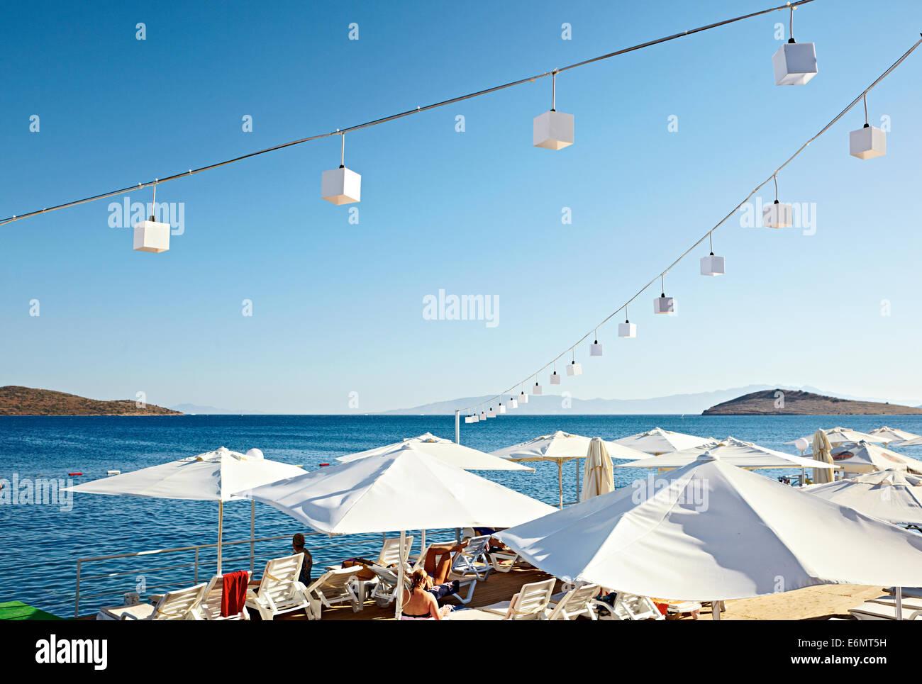 White umbrellas clear blue sky - Stock Image