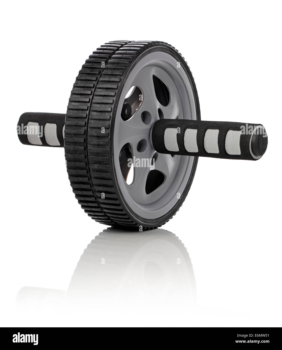 Ab roller wheel used for exercising abdominal muscles. - Stock Image