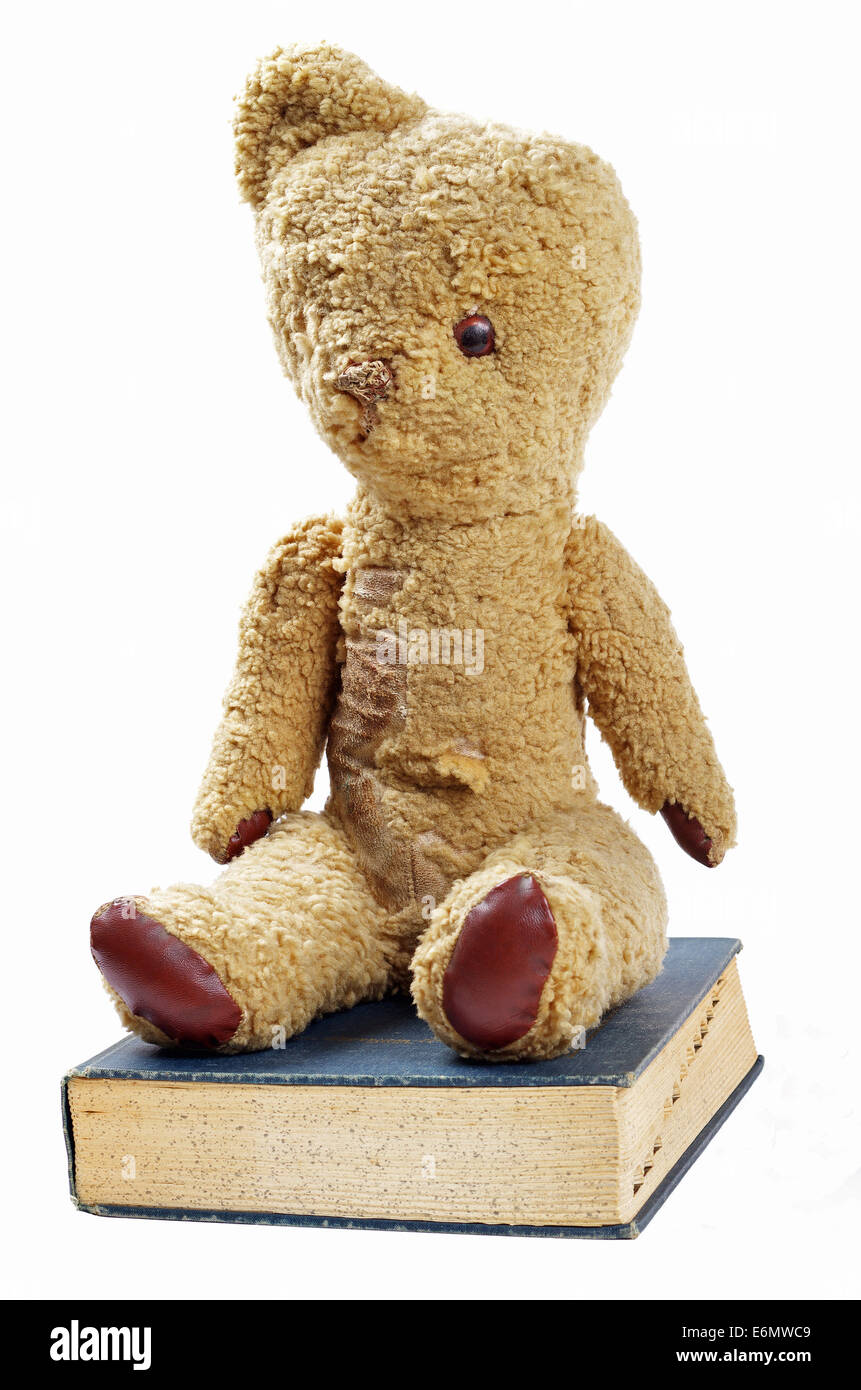 antique teddy bear and book - Stock Image