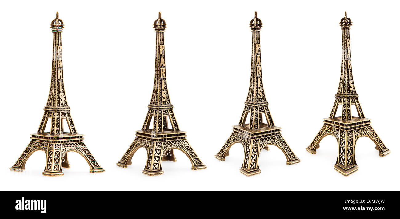 Close up view of a small Eiffel tower statue photographed with different perspectives on white background Stock Photo