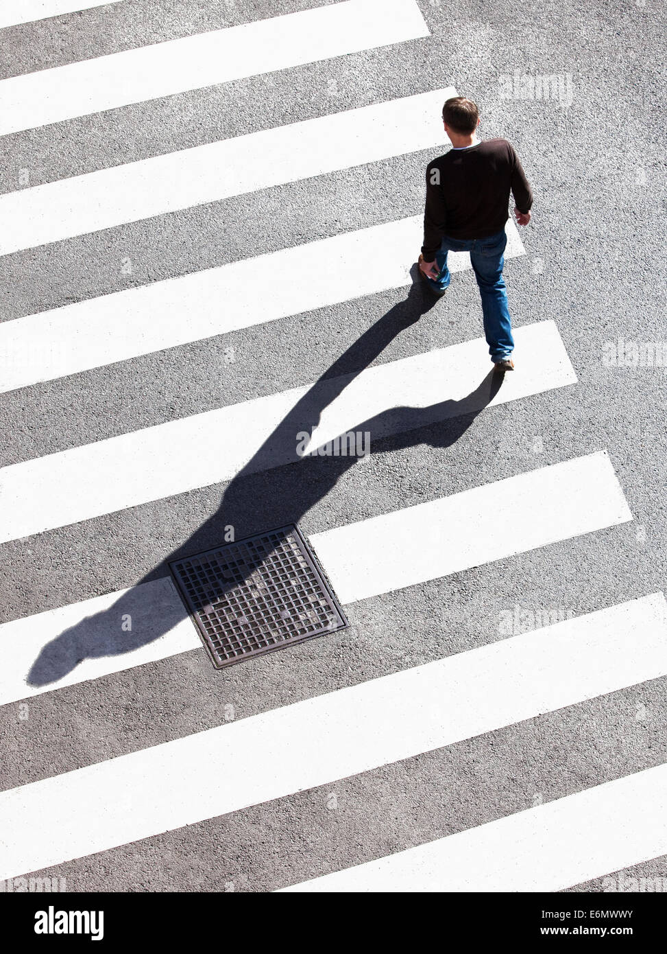 Pedestrian Crossing the Street on Zebra Crossing. - Stock Image