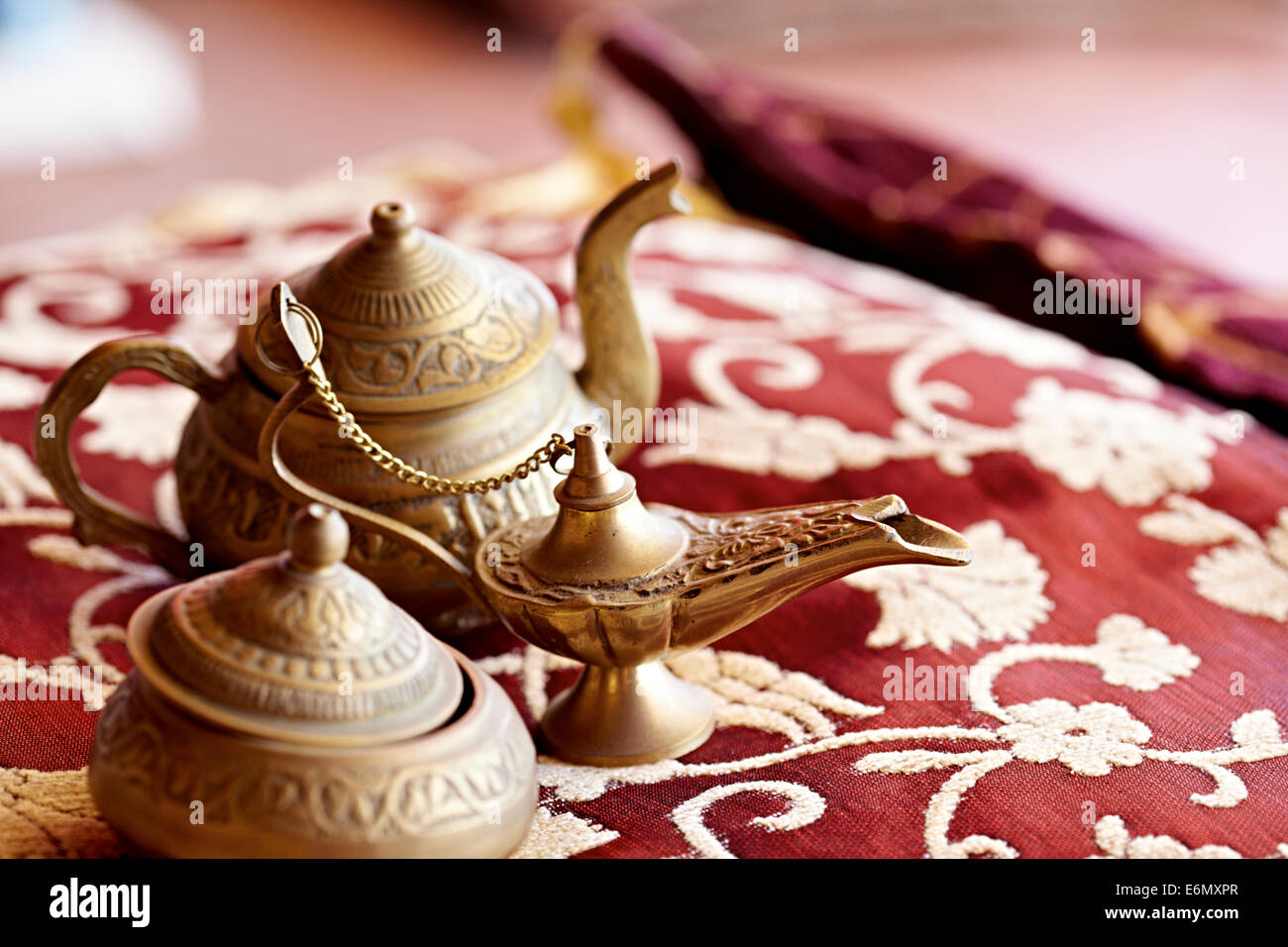 Turkish teapots on red rug - Stock Image