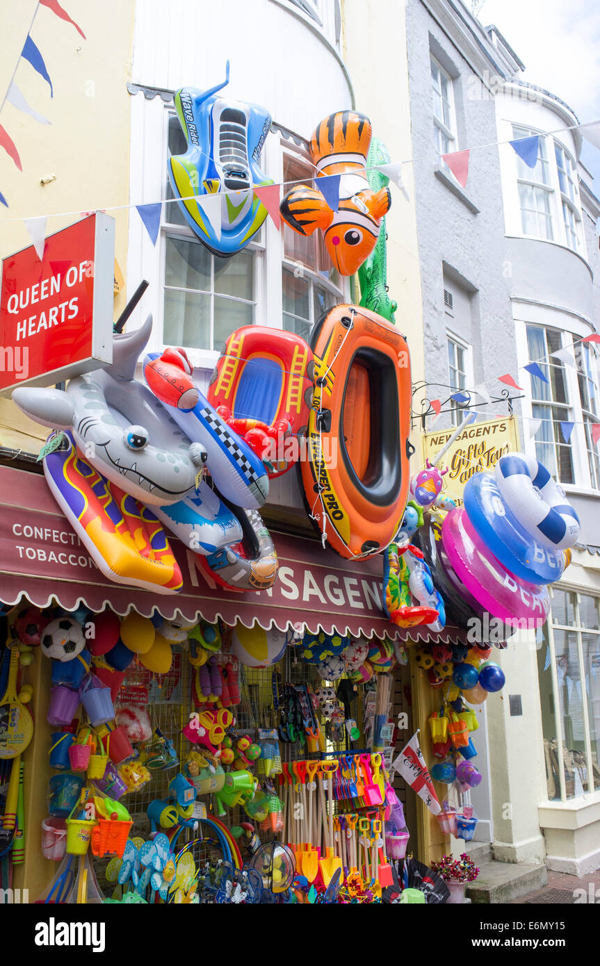 Seaside beach inflatable toys hanging outside of a shop in Weymouth Dorset UK Stock Photo