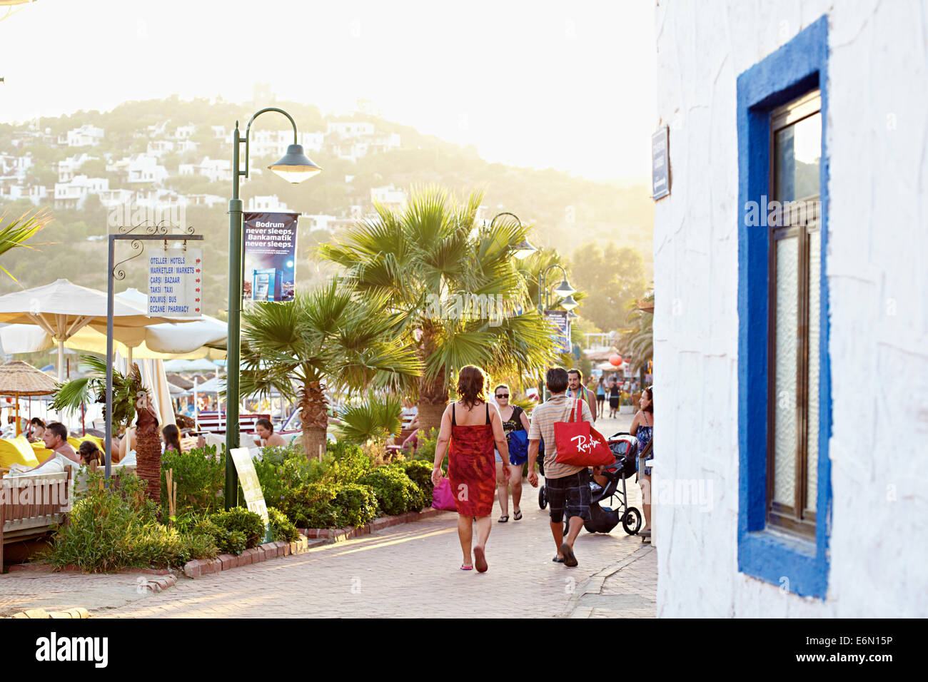 Street view with blue window couples walking - Stock Image