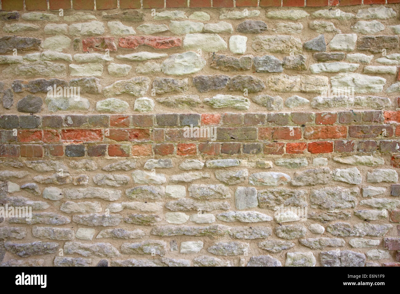 Georgian chalk stone and reclaimed brick wall - Stock Image