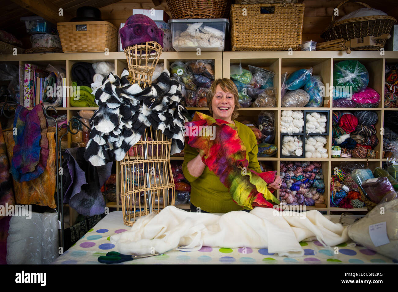 Chrissie Menzies - felt maker , Chrysalis - Art to Wear , with her work in her studio at Llanerfyl, Powys Wales - Stock Image