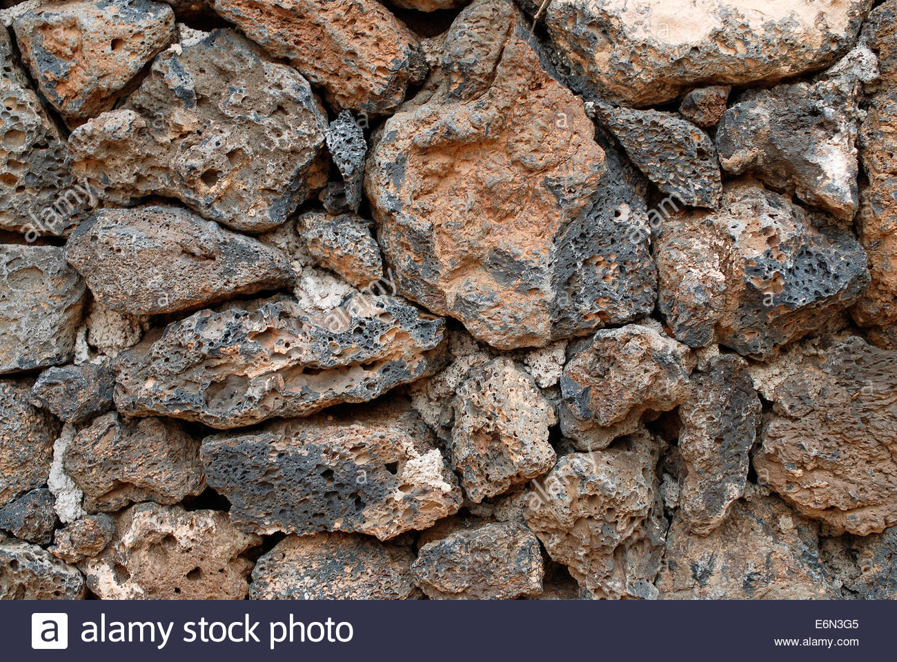 Volcanic rock stone wall background - Stock Image