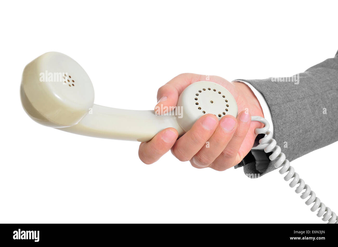 closeup of the hand of a man wearing a suit holding the handset of a telephone - Stock Image