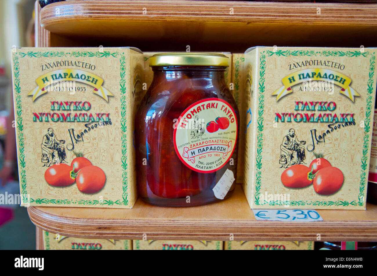 Preserved jarred sweet whole local tomatoes, Glyko Tomataki, Dimoiki Dorag market hall, Eleftherias square, Kos - Stock Image