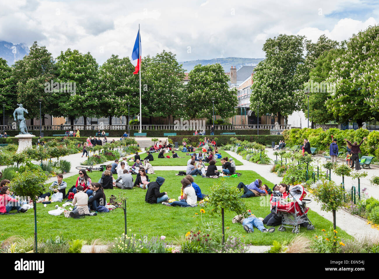 People sitting out in the public parks, Grenoble, Rohone-Alpes, France - Stock Image