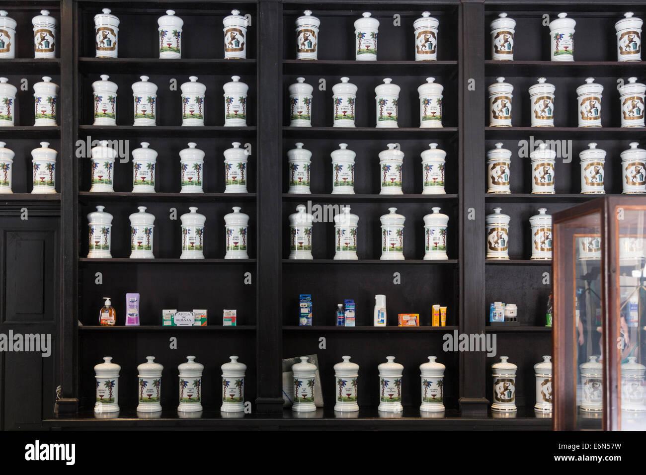 shelves full of apothecary jars, Drogueria Johnson pharmacy, Havana, Cuba - Stock Image