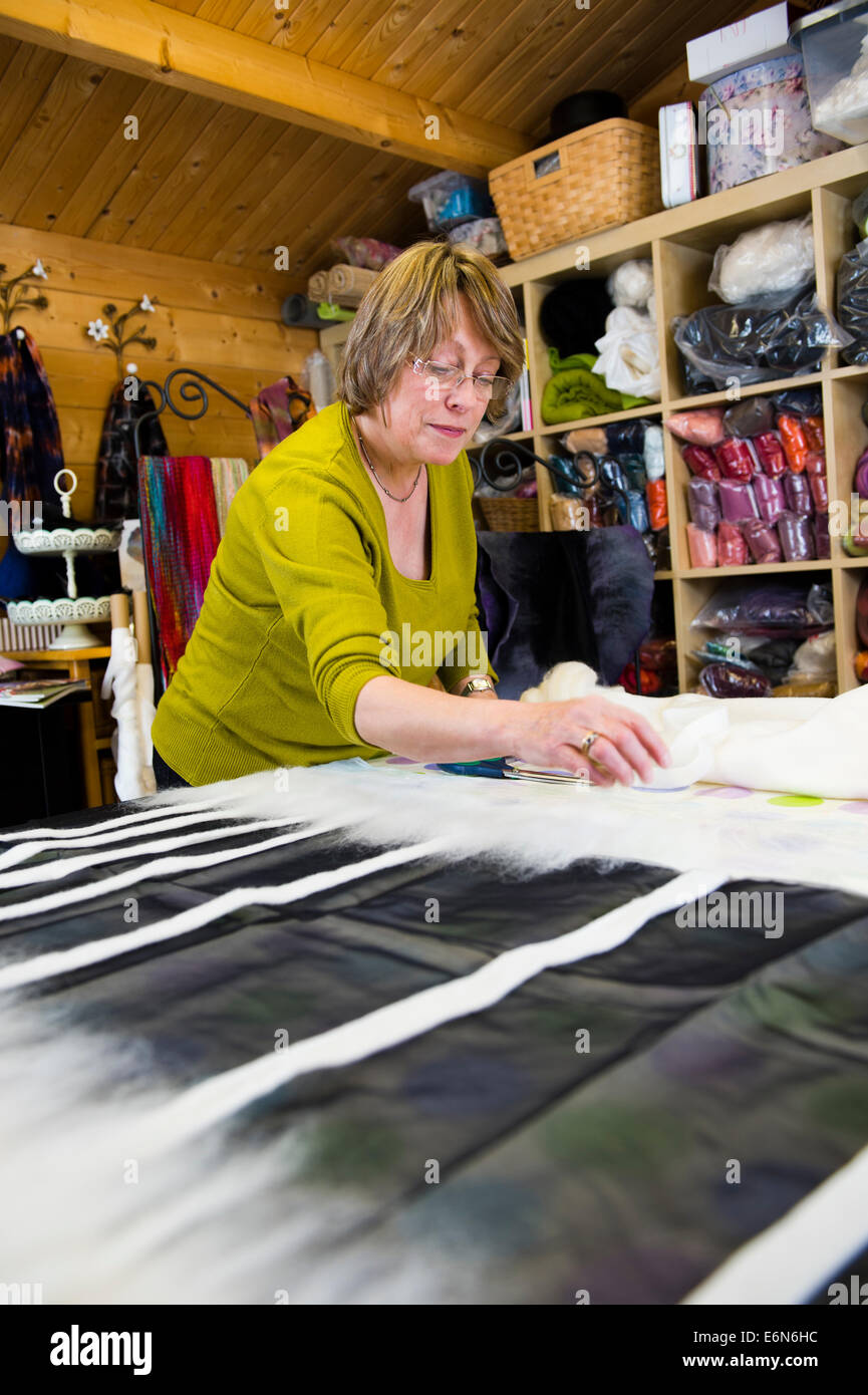 Chrissie Menzies - felt maker , Chrysalis - Art to Wear , in her studio at Llanerfyl, Powys Wales UK - Stock Image