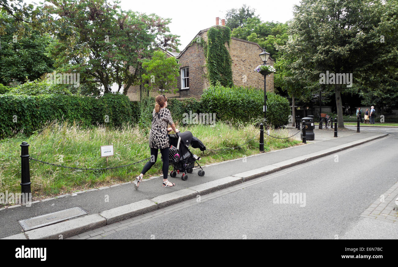 Woman with a pushchair walking on Orford Road in Walthamstow Village, North East London  E17 KATHY DEWITT Stock Photo