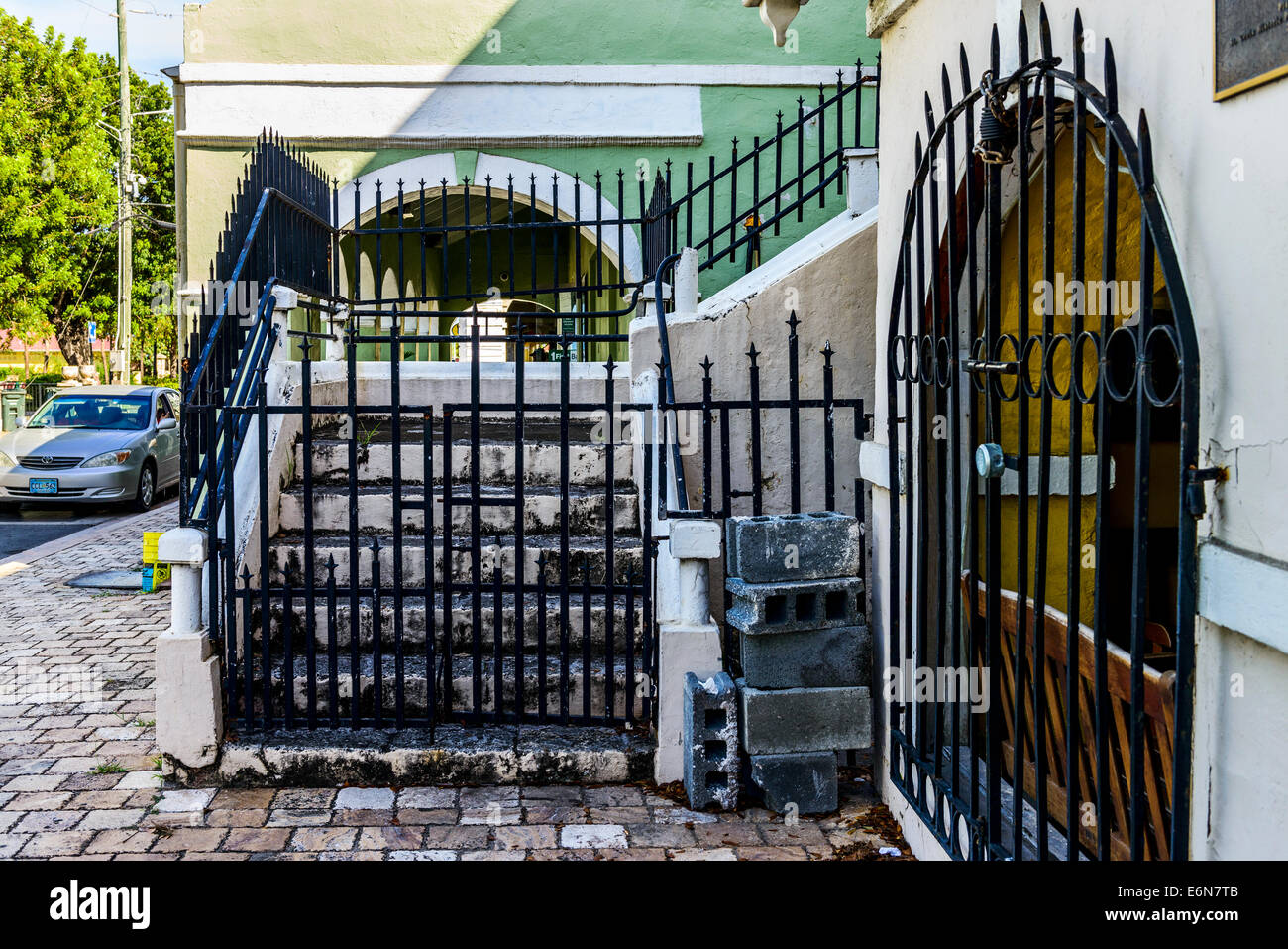 Stairs Behind A Wrought Iron Gate Leading To A Portico On A Home In  Frederiksted, St. Croix, U. S. Virgin Islands. USVI, U.S.V.I.