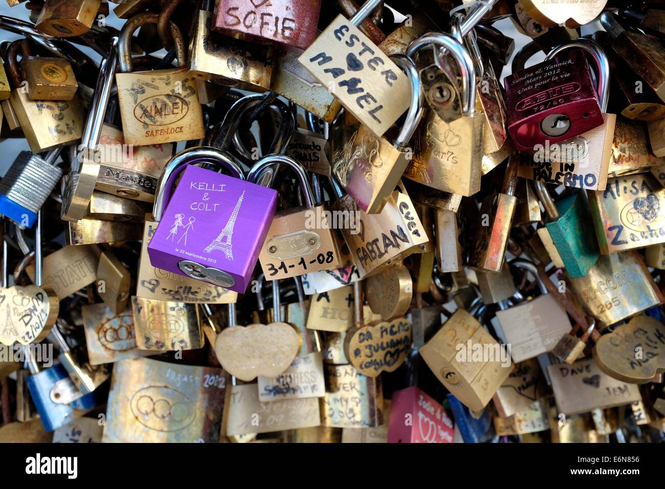 Padlocks adorn Pont des Arts (or lovers' bridge) in Paris, France - Stock Image