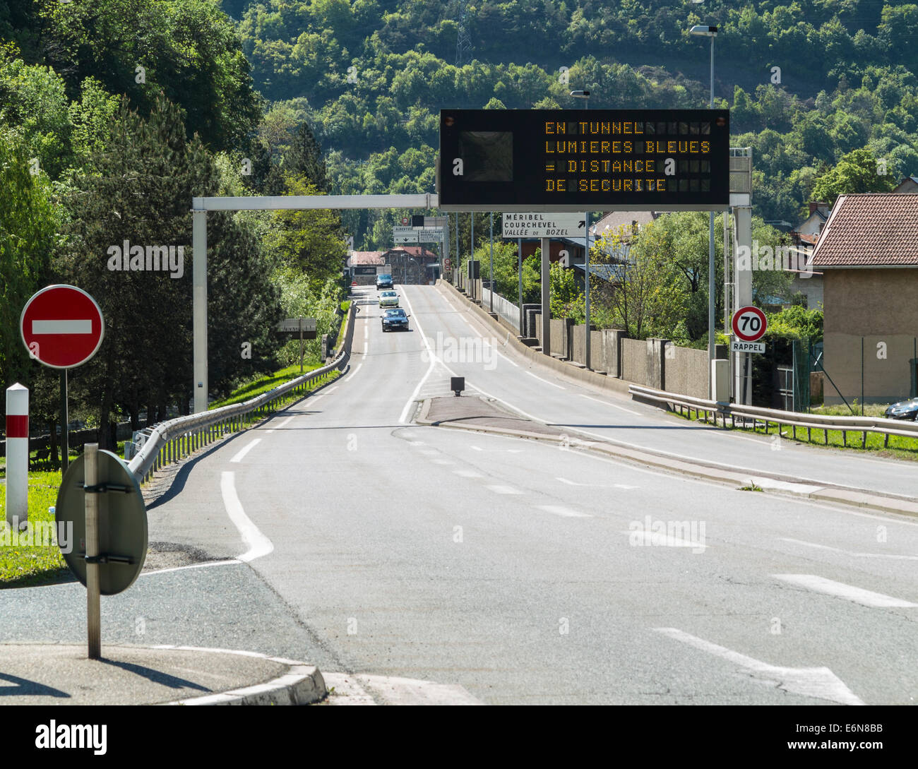 Road and warning gantry in Moutiers, Savoie, Rhone Alpes, France - Stock Image