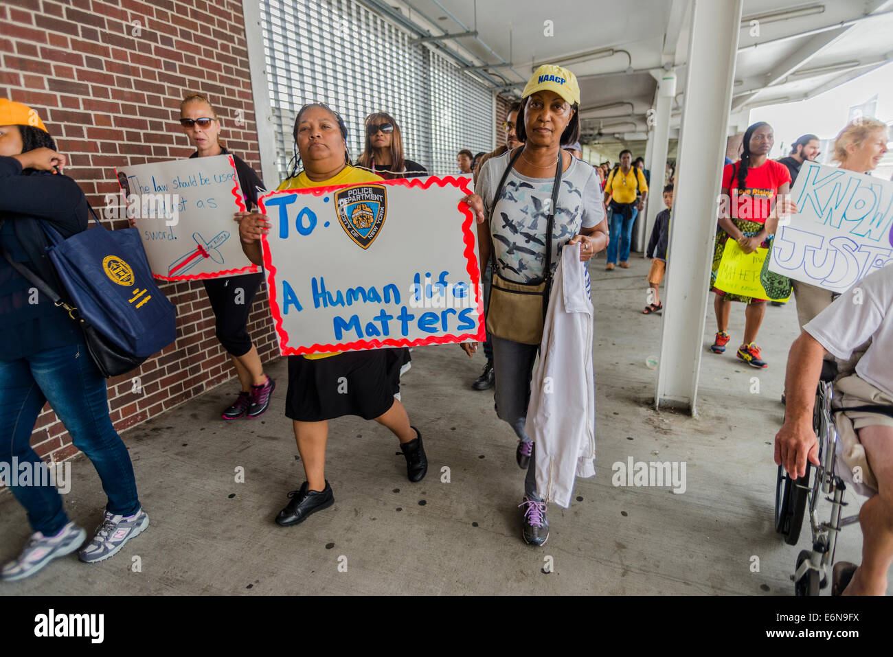 Staten Island, NY - Members of the NAACP leave the Staten Island Ferry Terminal to join the march to protest the - Stock Image
