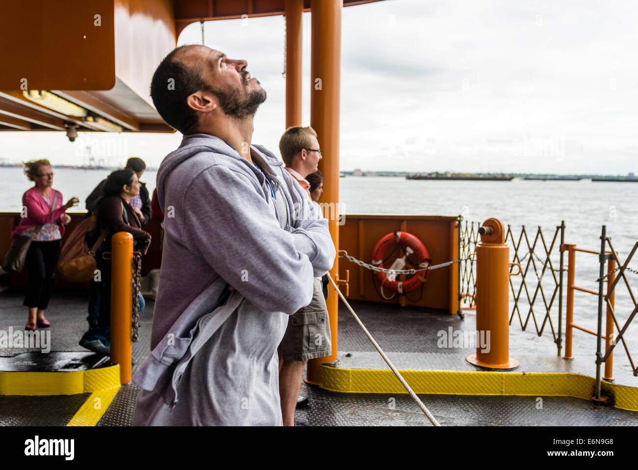 Staten Island, NY - 23 Aug 2014 - Man taking in a refreshing harbor breeze on the Staten Island Ferry - Stock Image