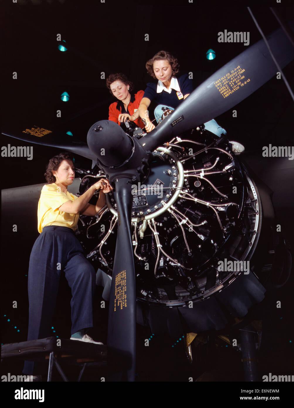Women at work on C-47 Douglas cargo transport, Douglas Aircraft Company, Long Beach, California, 1942 - Stock Image