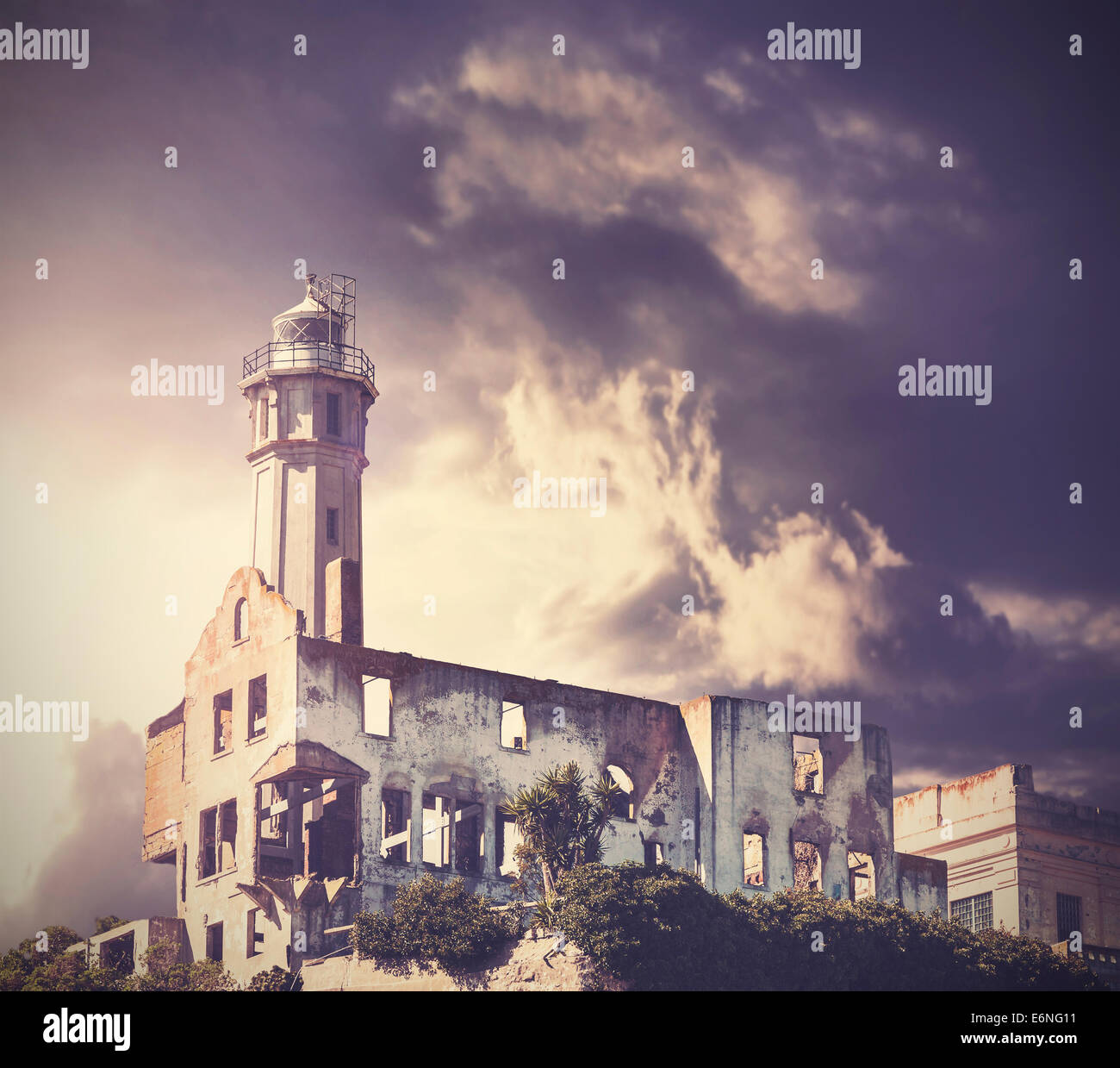Vintage picture of dramatic rainy sky over Alcatraz Island in San Francisco, USA. - Stock Image