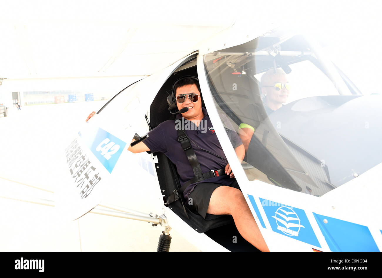 (140828) -- FAKU, Aug. 28, 2014 (Xinhua) -- Zhao Wei, leader of the Red Bull Aerobatic Team of China, takes part - Stock Image