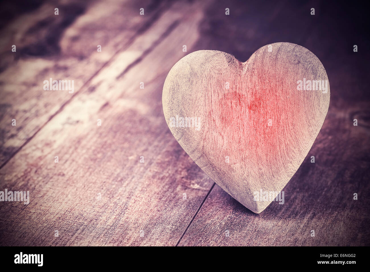 Vintage style heart on rustic wooden background, text space. - Stock Image