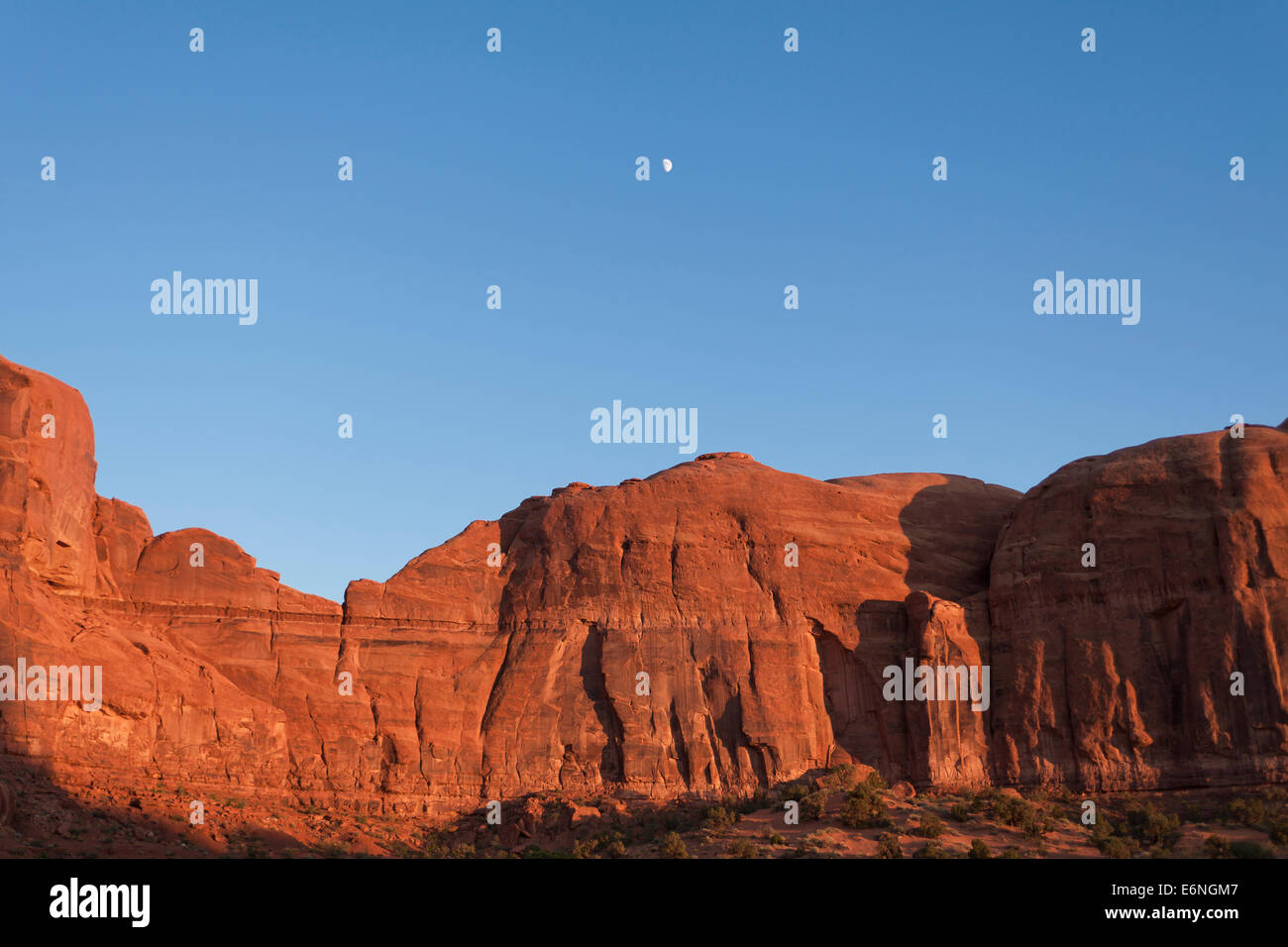 Exposed red sandstone rock formation lit by late afternoon sun - Utah USA - Stock Image