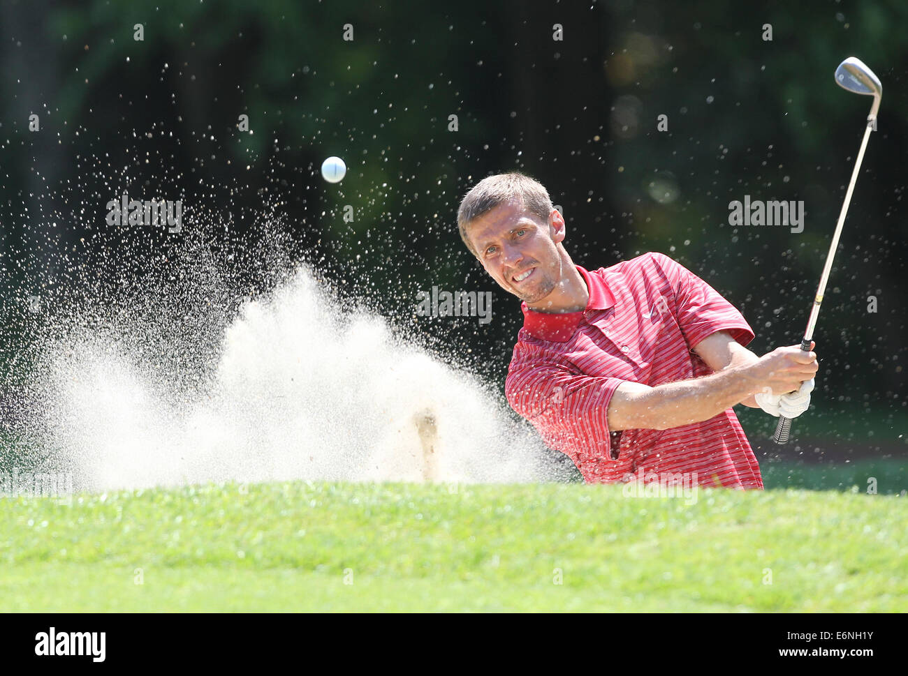 Gary O'Neil plays a shot out of a bunker during the EuroPro Golf Tournament 2012 at Bovey Castle, Devon - Stock Image