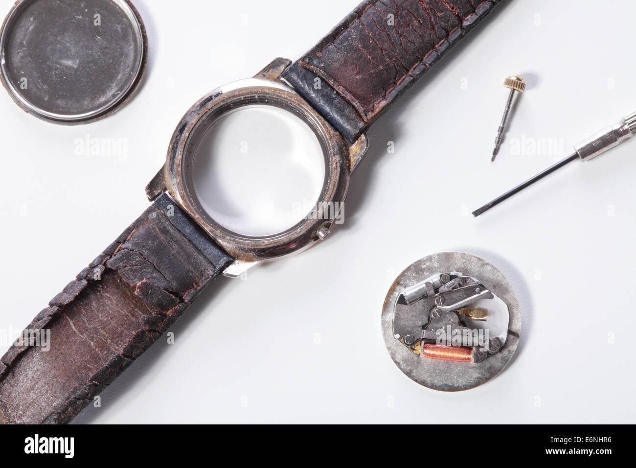 repairing an old and broken clock - Stock Image