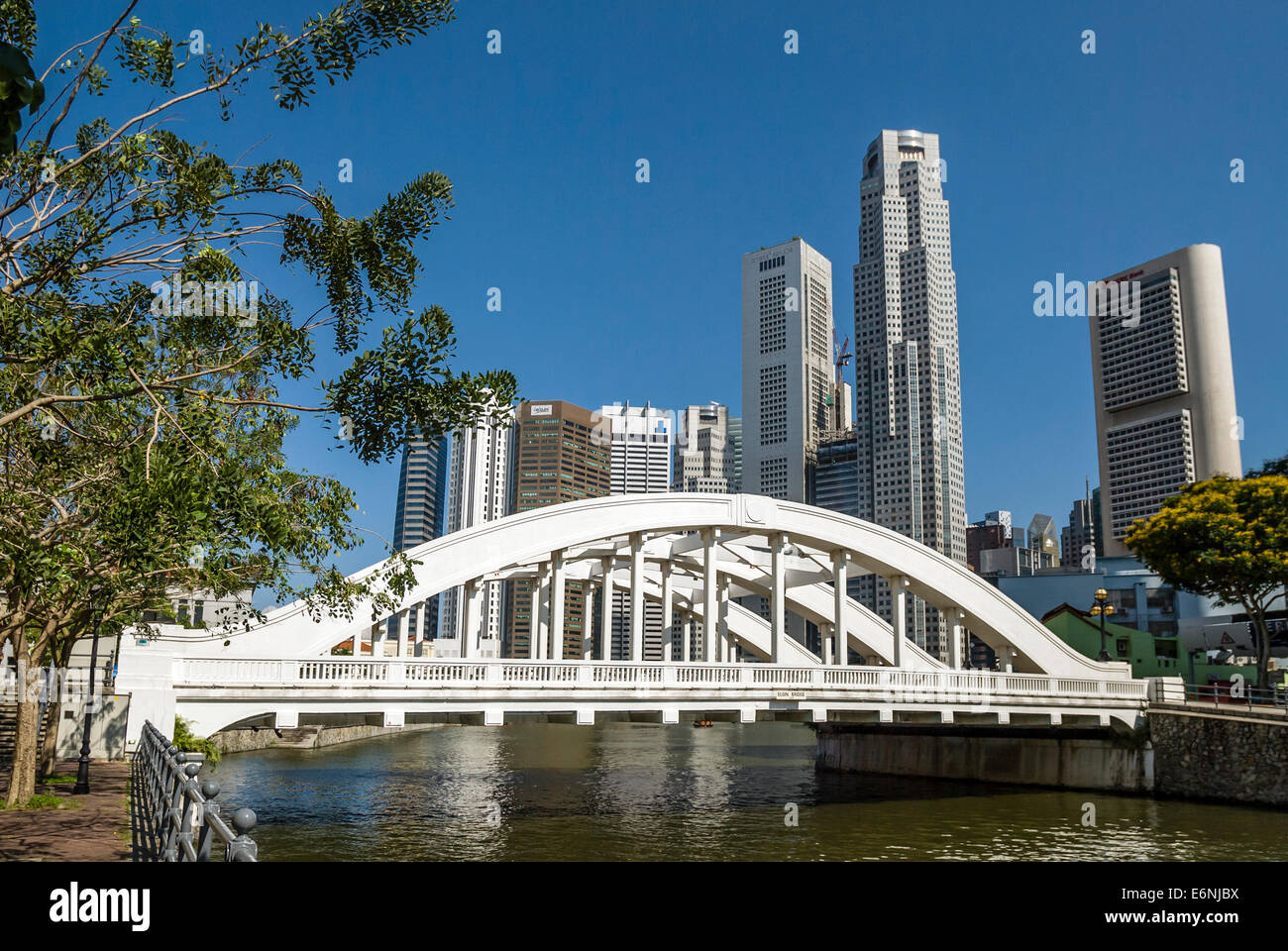 Elgin Bridge is a vehicular bridge across the Singapore River in downtown Singapore, with the skyline in the background. - Stock Image