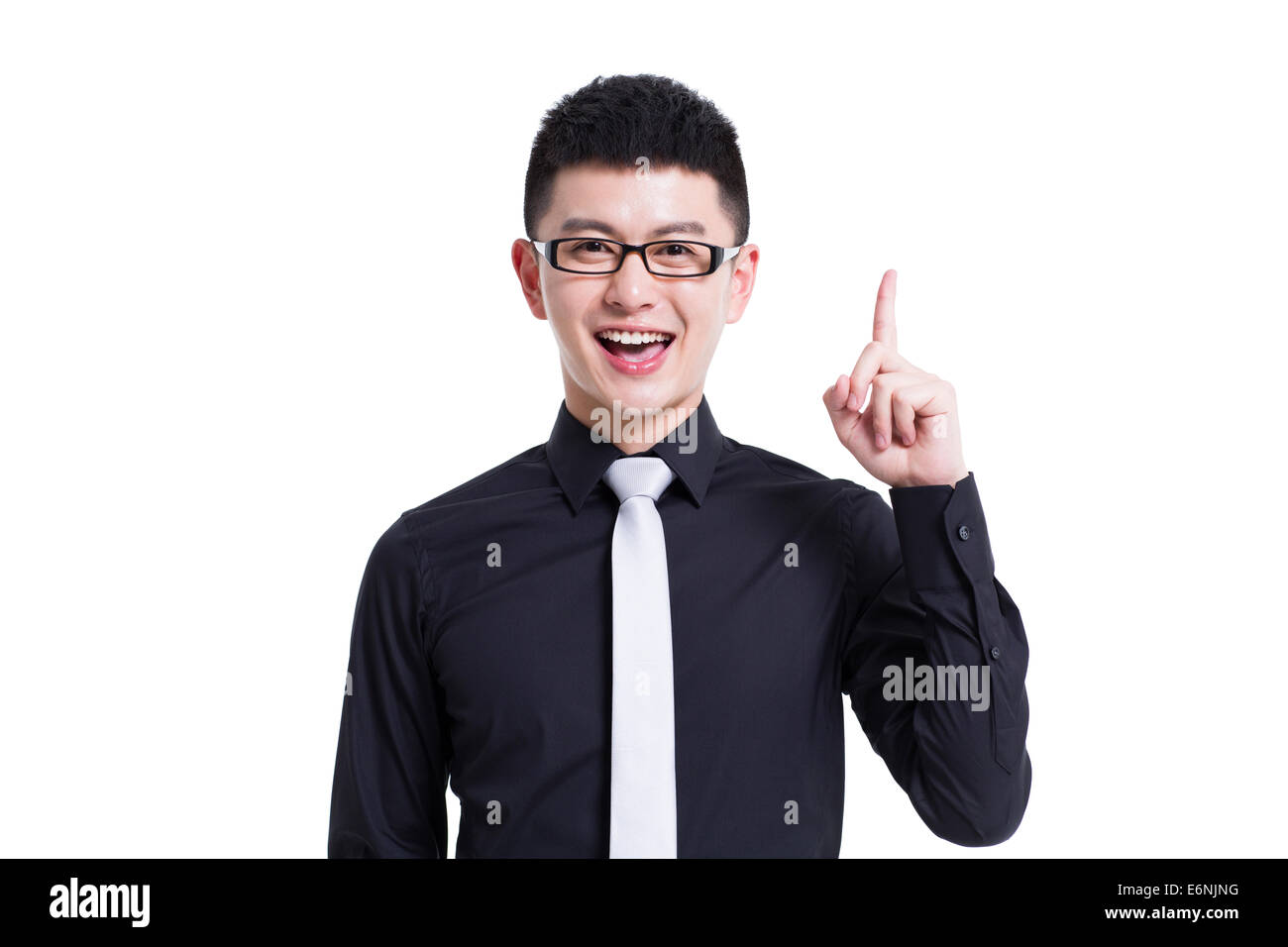 Cheerful young man pointing - Stock Image