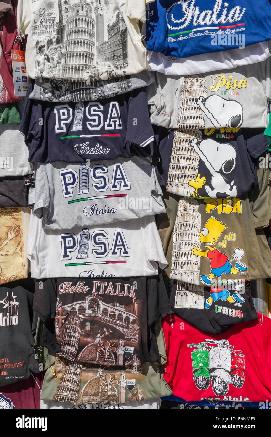 An assortment of tee shirts advertising Pisa and its leaning tower. - Stock Image